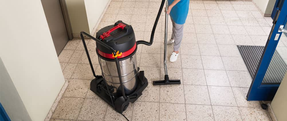 cropped image of a man with professional vacuum cleaner