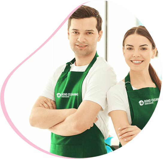 beautiful woman in green apron standing with spray bottle and rag in hand