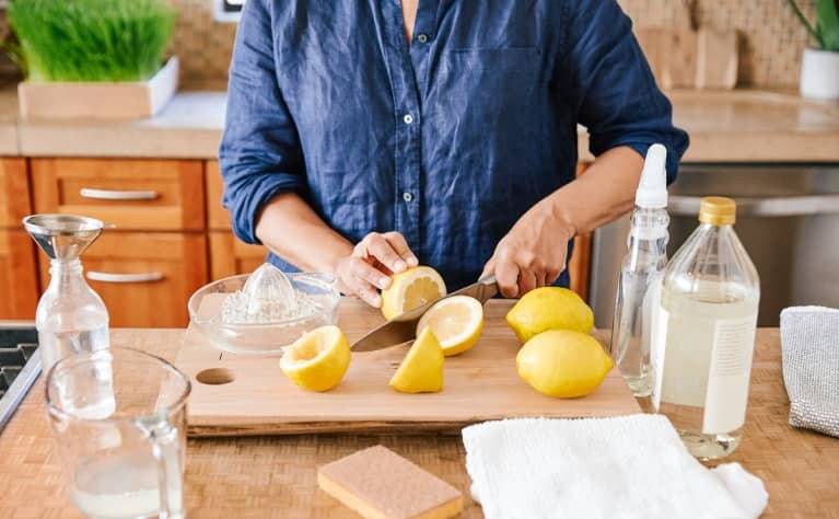 cropped image of a woman chopping the lemon