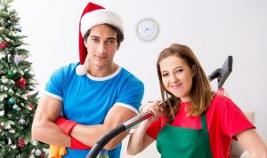 young couple preparing their house for Christmas