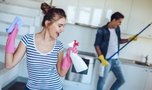 young couple enjoying the house sprucing chores