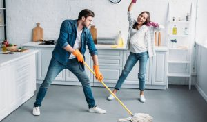 young happy couple sprucing a kitchen